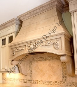stone range hood in luxury kithens
